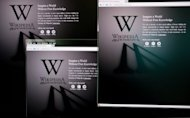 File photo shows a computer screen displaying homepages of the Wikipedia site darkened on January 18 in a protest against US legislation intended to crack down on online piracy. The Russian-language Wikipedia website shut down Tuesday with a stark black line across its main page in protest at a bill it warned could be used to censor the Internet