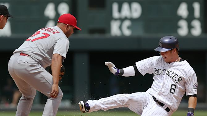 Adams homers, Cardinals rally to beat Rockies 9-6