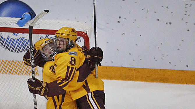 Minnesota forward Hannah Brandt (22) and forward Amanda Kessel celebrate after Kessel's goal against Boston University in the women's Frozen Four NCAA Championship college hockey game, Sunday March 24, 2013, in Minneapolis. Minnesota won 6-3. (AP Photo/Stacy Bengs)