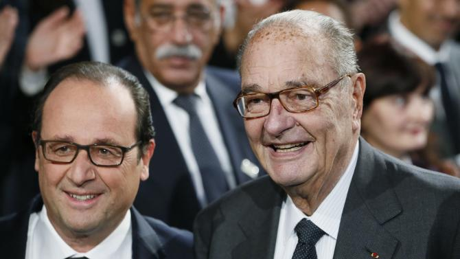 French President Francois Hollande and former French President Jacques Chirac pose before attending the award ceremony for the Prix de la Fondation Chirac at the Quai Branly Museum in Paris