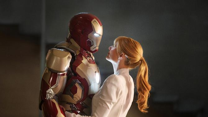 """This film publicity image released by Disney-Marvel Studios shows Robert Downey Jr., left, as Tony Stark/Iron Man and Gwyneth Paltrow as Pepper Potts in a scene from """"Iron Man 3.""""  (AP Photo/Disney, Marvel Studios)"""