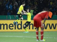 Borussia Dortmund's Robert Lewandowski (L) celebrates with teammate Neven Subotic after Lewandowski scored during the German Cup final against Bayern Munich on May 12