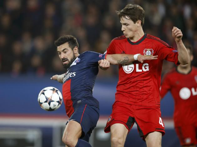 Paris St Germain's Ezequiel Lavezzi challenges Bayer Leverkusen's Philipp Wollscheid during their Champions League round of 16 second leg soccer match at the Parc des Princes Stadium in Paris