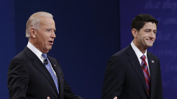 Vice President Joe Biden, left, and Republican vice presidential nominee Paul Ryan, of Wisconsin, greet spectators during the vice presidential debate at Centre College, Thursday, Oct. 11, 2012, in Danville, Ky. (AP Photo/Eric Gay)