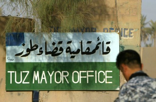An Iraqi soldier guards the entrance to the Mayor's office in the town of Tuz Khurmatu in 2010. Gunmen killed six young Arab men while they were swimming in a predominantly Turkmen town in north Iraq on Saturday, security and medical officials said
