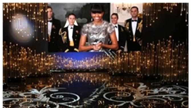 FILE - In this combination of photos made on Sunday, Feb. 24, 2013, first lady Michelle Obama, appearing via video link, and actor Jack Nicholson present the award for best picture during the Oscars ceremony at the Dolby Theatre in Los Angeles. As seen in the bottom photo, the first lady wore a sleeveless, scoop neck gown for the occasion. The photo on top is an altered version that Iran's semi-official Fars news agency ran on their website, with her shoulders and neckline covered with added material to make her gown look less revealing. (AP Photo/Invision (below), Fars (above))