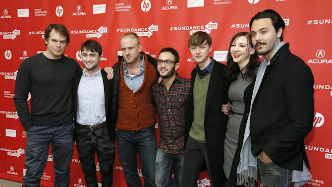 """Cast members from left, Michael C. Hall, Daniel Radcliffe, Ben Foster, director John Krokidas, Dane DeHaan, Erin Darke, and Jack Huston pose together at the premiere of """"Kill Your Darlings"""" during the 2013 Sundance Film Festival on Friday, Jan. 18, 2013 in Park City, Utah. (Photo by Danny Moloshok/Invision/AP)"""