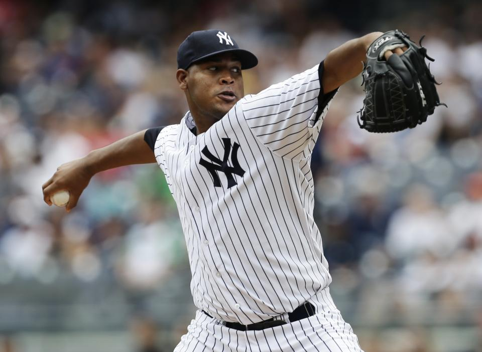 New York Yankees' Ivan Nova delivers a pitch during the first inning of a baseball game against the Tampa Bay Rays Saturday, July 27, 2013, in New York. (AP Photo/Frank Franklin II)