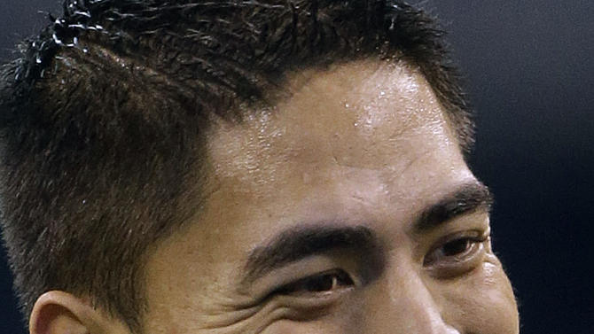 Notre Dame linebacker Manti Te'o smiles during the NFL football scouting combine in Indianapolis, Monday, Feb. 25, 2013. (AP Photo/Dave Martin)