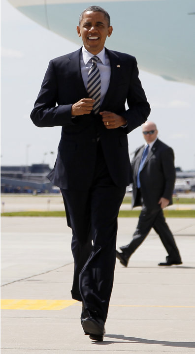 President Barack Obama jogs to greet people on the tarmac as he arrives at Minneapolis-St. Paul International Airport in Minneapolis, Friday, June 1, 2012. (AP Photo/Carolyn Kaster)