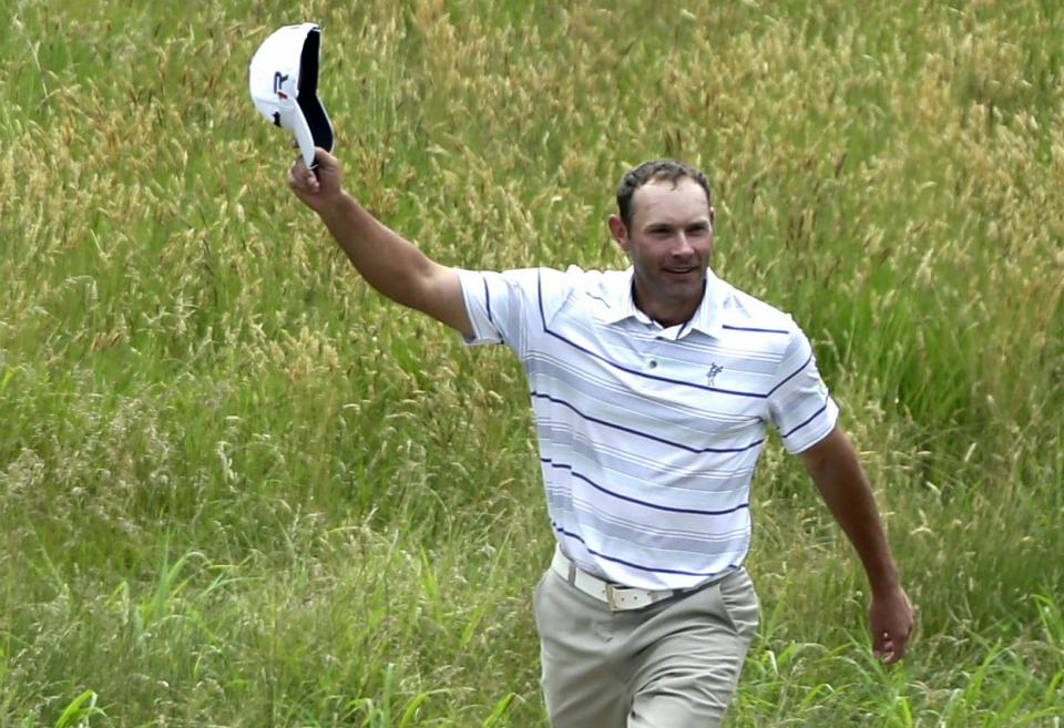 Shawn Stefani acknowledges the gallery after hitting a hole in one on the 17th hole during the fourth round of the U.S. Open golf tournament at Merion Golf Club, Sunday, June 16, 2013, in Ardmore, Pa. (AP Photo/Julio Cortez)