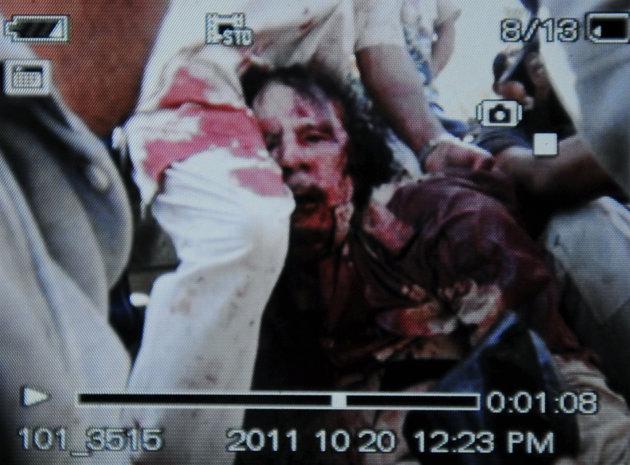 War in Libya - Page 2 Gaddafi---GettyImages-129722304_124210