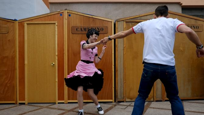 People dressed in fifties-style outfits, dance during the 22th Rockin' Race Jamboree International Festival in downtown Torremolinos