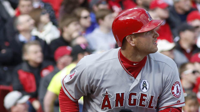 Los Angeles Angels catcher Chris Iannetta hits a solo home run off Cincinnati Reds starting pitcher Johnny Cueto in the third inning of an opening day baseball game, Monday, April 1, 2013, in Cincinnati. (AP Photo/David Kohl)