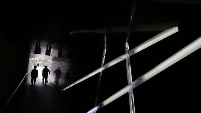 Visitor walk by light decorations at a tunnel near the Cheonggye stream in Seoul, South Korea, Tuesday, July 28, 2015. (AP Photo/Lee Jin-man)