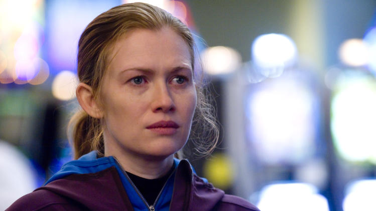 "FILE - In this publicity file photo released by AMC, Mireille Enos is shown in a scene from ""The Killing.""  Enos and her co-star Joel Kinnaman failed to snag an Emmy nomination on Thursday, July 19, 2012, for their roles in the popular murder series. (AP Photo/AMC, Carole Segal, File)"