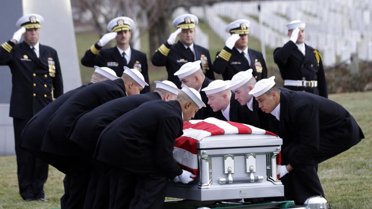 Sailors salute as one of two honor guard team places a casket of remains, during services to honor two sailors from the Civil War ship, the USS Monitor, at Arlington National Cemetery, Friday, March 8, 2013 in Arlington, Va. A century and a half after the Civil War ship the USS Monitor sank, two unknown crewmen found in the ironclad's turret were buried at Arlington National Cemetery. Friday's burial may be the last time Civil War soldiers are buried at the cemetery. (AP Photo/Alex Brandon)