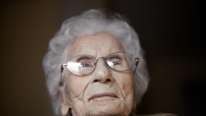FILE - In this Feb. 1, 2011 file photo, Besse Cooper, sits in her room at a nursing home, in Monroe, Ga. Cooper, who is listed as the world's oldest person, will mark her 115th birthday Friday, Aug. 26, 2011.  (AP Photo/David Goldman, File)