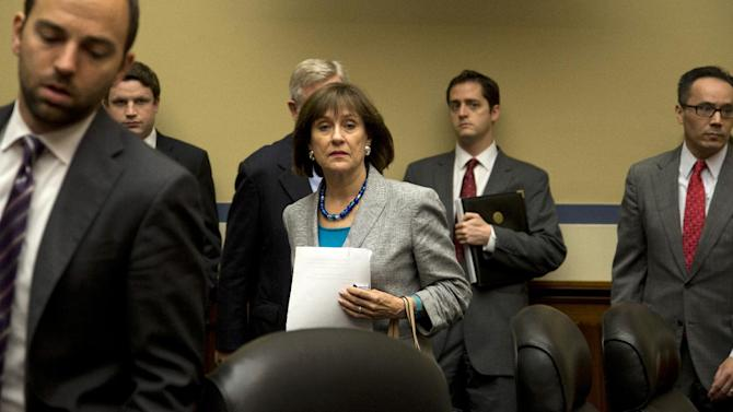 IRS official Lois Lerner arrives on Capitol Hill in Washington, Wednesday, May 22, 2013, to testify before the House Oversight and Government Reform Committee hearing to investigate the extra scrutiny IRS gave to Tea Party and other conservative groups that applied for tax-exempt status.  Lerner told the committee she did nothing wrong and then invoked her constitutional right to not answer lawmakers' questions. (AP Photo/Carolyn Kaster)