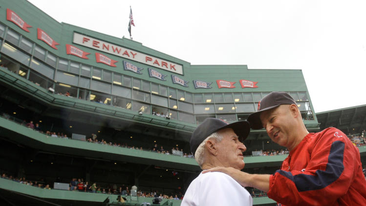 FILE - In this Sept. 28, 2008, file photo, Boston Red Sox great Johnny Pesky, left, is embraced by manager Terry Francona during a ceremony where Pesky's No. 6 was retired prior to a baseball game against the New York Yankees at Fenway Park in Boston. Pesky, who spent most of his 60-plus years in pro baseball with the Red Sox and was beloved by the team's fans, has died on Monday, Aug. 13, 2012, in Danvers, Mass. He was 92. (AP Photo/Charles Krupa, File)