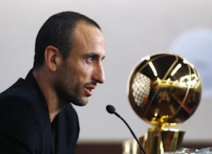 Spurs guard Manu Ginobili of Argentina speaks during a news conference upon his arrival at the airport in Buenos Aires