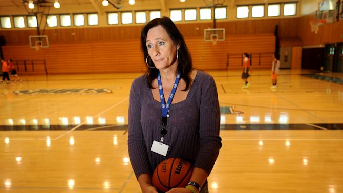 Gabrielle Ludwig, a 6-foot-6-inch transsexual player on Mission College's women's basketball squad, reflects on her return to college ball on Friday, Dec. 7, 2012, in Santa Clara, Calif. Gabrielle Ludwig made sports history this month as a basketball player at a Northern California community college. The 50-year-old transsexual, Army veteran, father and Mission College freshman is believed to be the first hoopster to play college ball as both a man and a woman. (AP Photo/Noah Berger)