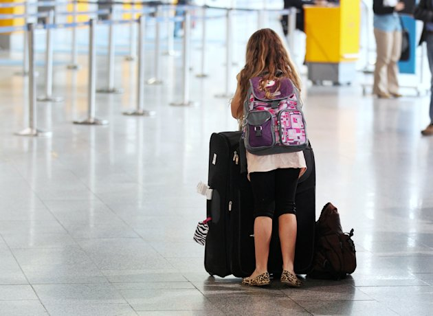 A girl stands in a a terminal at the international airport in Frankfurt, Germany, Tuesday, March 27, 2012. More than 400 flights had to be cancelled when ground staff organized in the German ver.di union went on a warning strike for higher wages until the afternoon.(AP Photo/Michael Probst)