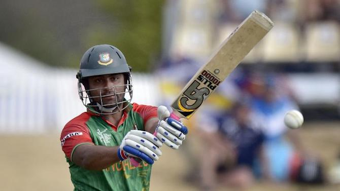 Bangladesh's batsman Tamim Iqbal plays a shot during their Cricket World Cup Pool A match against Scotland, at Saxton Park Oval in Nelson, on March 5, 2015