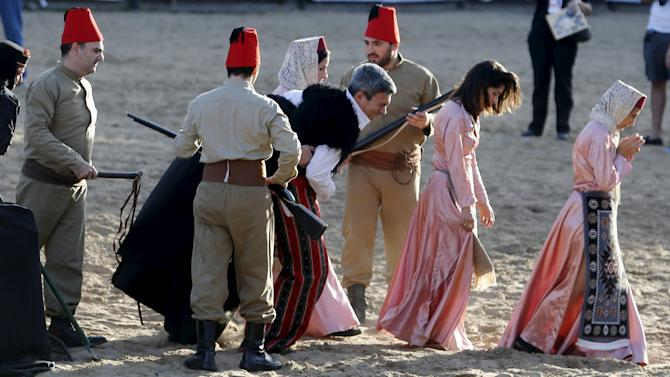 Performers reenact the capture of Armenians during a commemoration marking the 100th anniversary of the mass killing of Armenians by OttomanTurks, in Buenos Aires