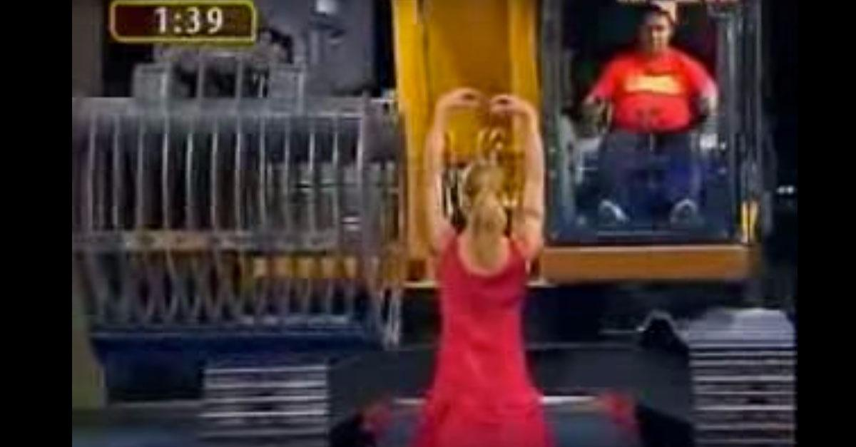 Odd Gameshow Has Guy Undress Lady with Excavator!