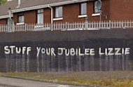 <p>Anti-monarchy graffiti pictured on a wall in west Belfast, Northern Ireland. Queen Elizabeth II made a historic gesture in Northern Ireland's peace process when she shook the hand of former IRA commander Martin McGuinness.</p>