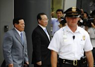 "North Korean Vice Foreign Minister Kim Kye-Gwan (C) departs the US Mission to the United Nations after meetings with Ambassador Stephen Bosworth, the Obama administration's top envoy on North Korean affairs. The United States on Thursday pressed North Korea to take ""concrete and irreversible"" steps to give up its nuclear arsenal at talks on how to improve hostile relations"