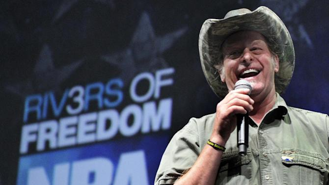 "FILE - In this May 1, 2011 file photo, musician and gun rights activist Ted Nugent addresses a seminar at the National Rifle Association's convention in Pittsburgh. Rep. Steve Stockman , R-Texas, says he's invited Nugent, who has referred to President Barack Obama's administration as ""evil, America-hating,"" to Tuesday's State of the Union address. (AP Photo/Gene J. Puskar, File)"