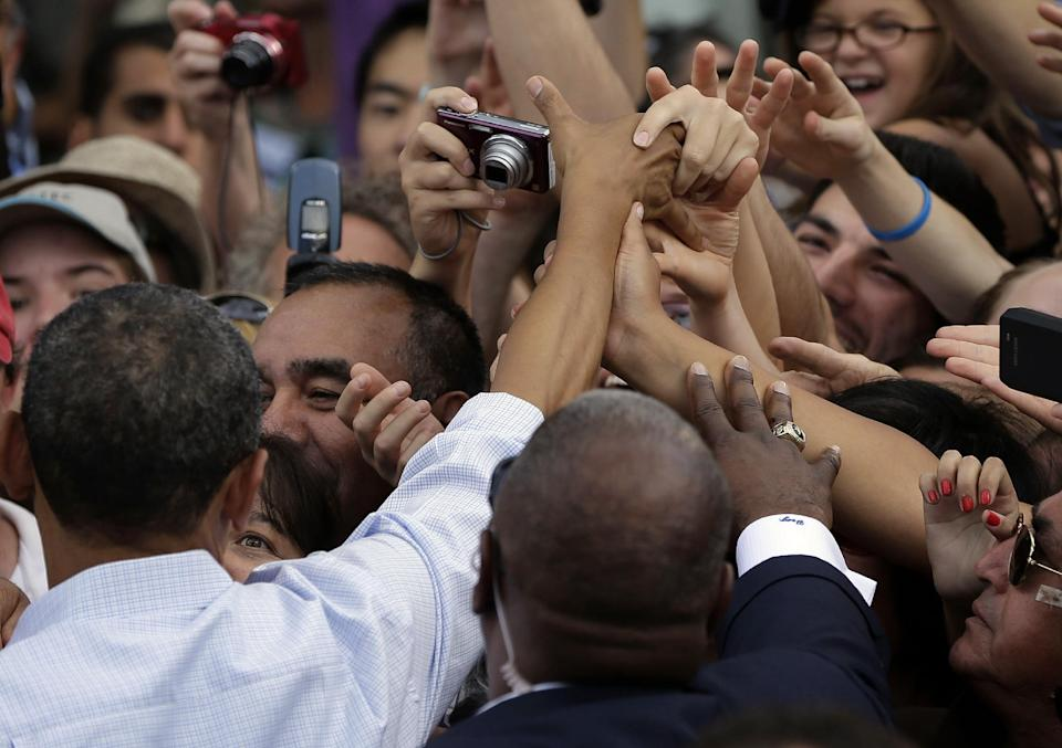 Supporters reaches out to shake President Barack Obama's hand during a campaign event at University of Colorado Boulder, Sunday, Sept. 2, 2012, in Boulder, Colo. (AP Photo/Pablo Martinez Monsivais)