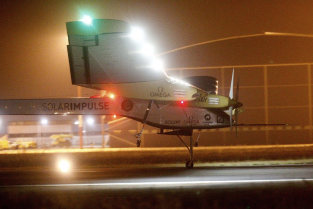 An experimental solar-powered plane, Solar Impulse, approaches to make a night landing at Rabat airport, Morocco, Tuesday, June 5, 2012 after a 20-hour trip from Madrid in the first transcontinental f