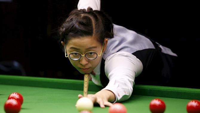 Ng On-yee, 25, 2015 Ladies World Snooker Championship winner, demonstrates her skill during an interview in Hong Kong