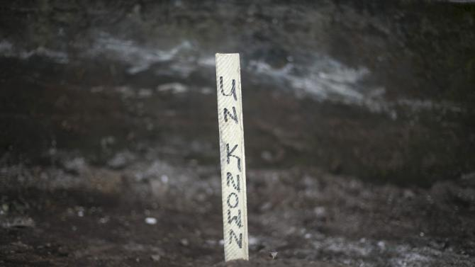 Sign marking an unidentified Ebola victim's grave is pictured at a cemetery in Freetown