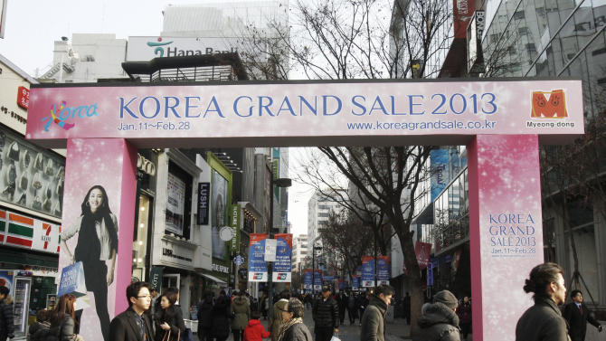 People walk on a shopping street in Seoul, South Korea, Friday, Jan. 11, 2013. South Korea's central bank cut its forecast for the country's economic growth this year due to slower corporate investment and uncertainties about the global economy. (AP Photo/Ahn Young-joon)