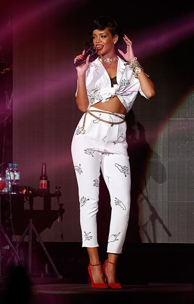 Day 5: Rihanna on stage in London (again) - The most feminine look of the week award goes to this one! Our girl was gorgeous in a Happy Ashley printed top and pants, What Katie Did bra, custom Manolo