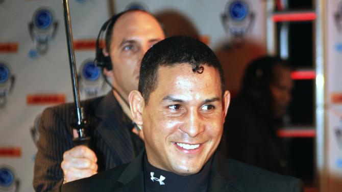 "FILE - In this Dec. 14, 2006, file photo, Hector ""Macho"" Camacho arrives for an event in Miami Beach, Fla. Police in Puerto Rico say former boxing champion Camacho has been shot and critically wounded. Camacho was shot in the face while in a car outside a bar in Bayamon, one of the cities that make up the San Juan metropolitan area. A statement from police in Bayamon said he was shot Tuesday night, Nov. 20, 2012. (AP Photo/Luis M. Alvarez, File)"