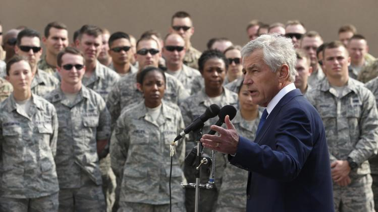 U.S. Secretary of Defense Hagel speaks to troops at Al Udeid Airbase, west of Doha