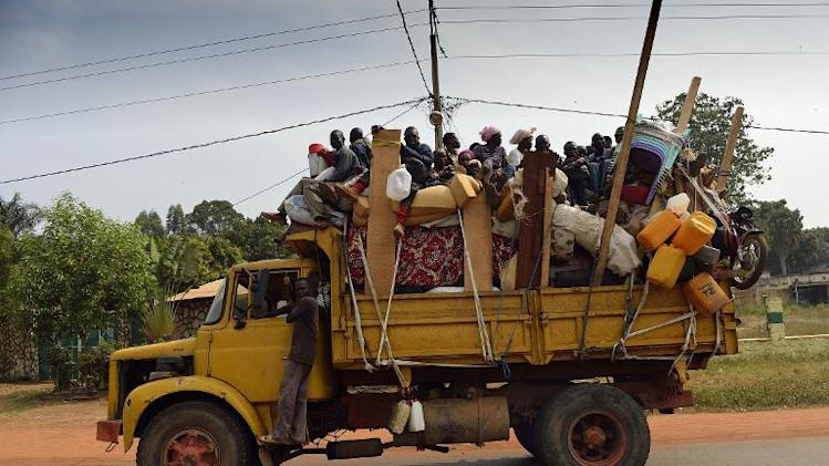 Muslim civilians ride a truck with their belongings as they flee the Central African Republic capital of Bangui on January 18, 2014