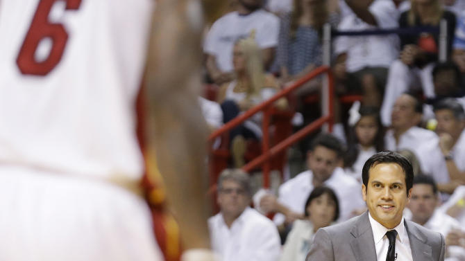 Miami Heat head coach Erik Spoelstra speaks to  LeBron James during the first half of Game 2 of the NBA Finals basketball game against the San Antonio Spurs, Sunday, June 9, 2013 in Miami.  (AP Photo/Lynne Sladky)
