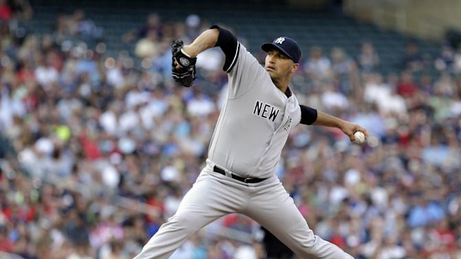 New York Yankees pitcher Andy Pettitte throws against the Minnesota Twins in the first inning of a baseball game, Monday, July 1, 2013, in Minneapolis. (AP Photo/Jim Mone)