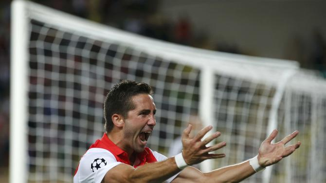AS Monaco's Moutinho celebrates after scoring the first goal for the team during their Champions League Group C soccer match against Bayer Leverkusen at Louis II stadium in Monaco