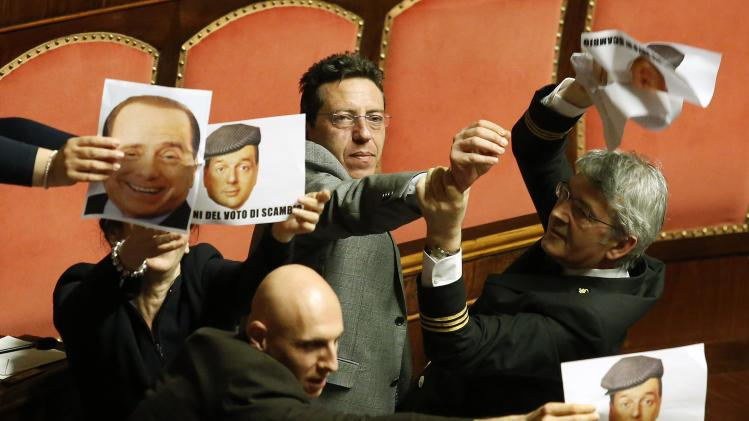 An usher tries to hold back opposition Five Star Movement senators during a vote in Rome