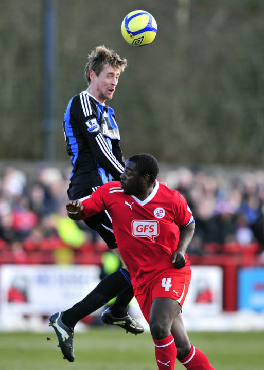 Stoke City's Striker Peter Crouch (L) Vies With Crawley Town's Defender Pablo Mills   AFP/Getty Images