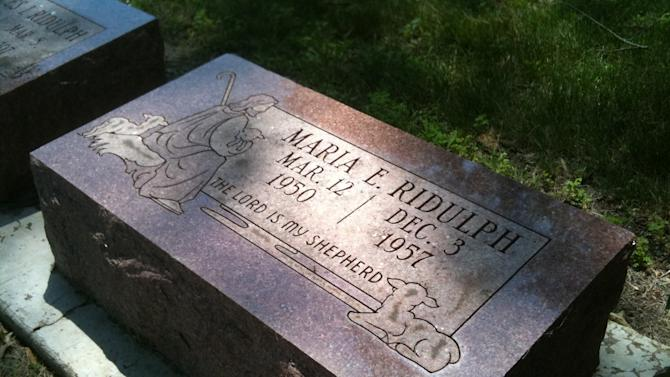 The grave site of Maria Ridulph at Elmwood Cemetery is shown in Sycamore, Ill.,  on Saturday, July 2, 2011. DeKalb County prosecutors charged Jack Daniel McCullough, 71, on Friday with murdering Ridulph, a 7-year-old Illinois girl who was last seen playing with a friend near her home in Sycamore, about 50 miles west of Chicago in 1957. (AP Photo/ Barbara Rodriguez)
