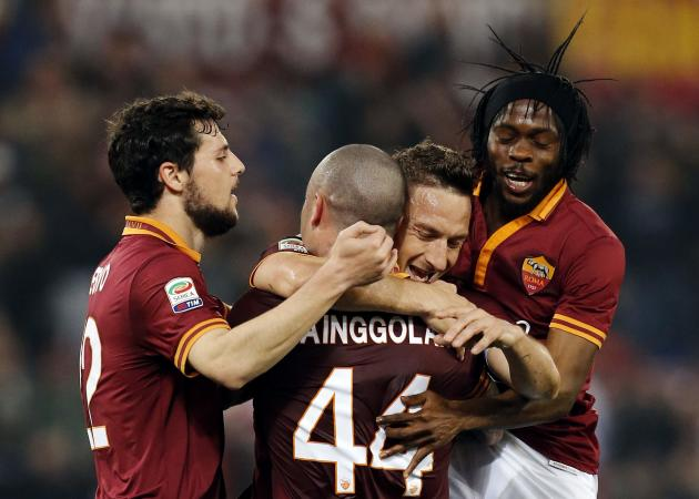 AS Roma's Totti celebrates with his teammates after scoring against Udinese during their Italian Serie A soccer match in Rome