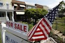 A U.S. flag decorates a for-sale sign at a home in the Capitol Hill neighborhood of Washington